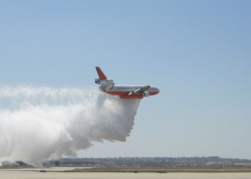 Tanker 910 dropping water during the 2012 March AirFest at March Air Field.