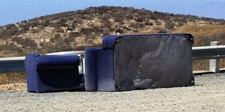 Abandoned couch by Lake Mathews
